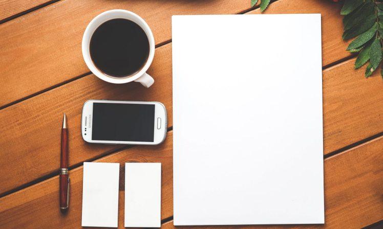 cropped-coffee-smartphone-desk-pen.jpg